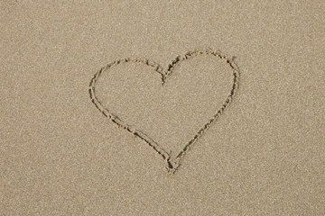 A heart symbol on the sandy beach.