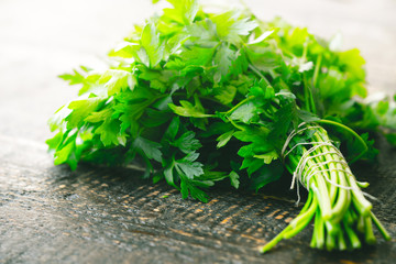 Bunch of parsley on the wooden table