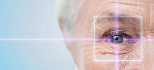 close up of senior woman eye with laser light