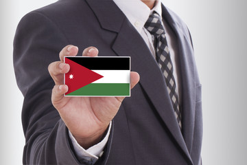 Businessman in suit holding a business card with Jordan Flag