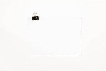 Blank stack of paper and paper clip