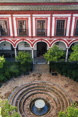 Inner courtyard of the Hospital de los Venerables Sacerdotes or  Hospital of the Venerable Priests, Seville, Andalusia, Spain