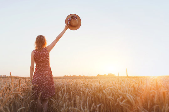 goodbye or parting background, farewell, woman waving hand in the field