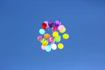 bunch of colorful balloons against the blue sky