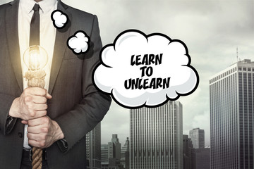 Learn to unlearn text on speech bubble with businessman