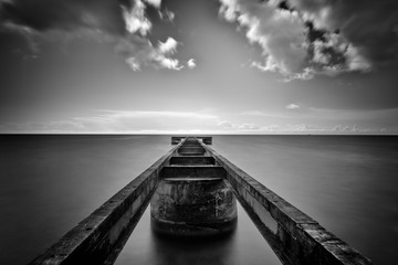 Jetty over sea with dramatic sky, Svarte, Skane County, Sweden, black and white