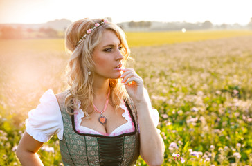 Pretty young german oktoberfest blonde woman wearing a dirndl