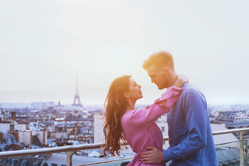 romantic couple in Paris, happy moment on Eiffel Tower background, honeymoon