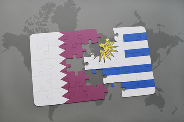 puzzle with the national flag of qatar and uruguay on a world map background.