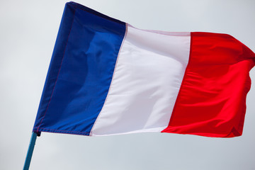 France flag waving close up on the sky