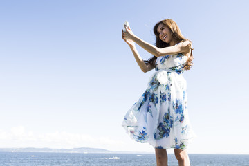 Women have taken a self-photo with the sea in the background