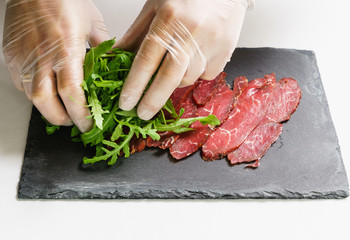 chef making beef carpaccio