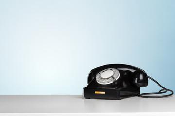 Retro black telephone on table