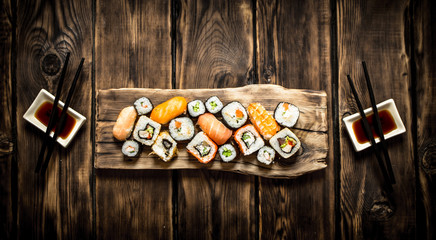 Sushi and rolls seafood with soy sauce.