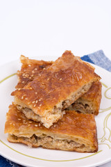 Homemade burek with minced meat over white background
