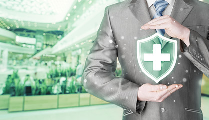 Health protection and insurance. Medical healthcare. Business in health safety. Blurred mall background.