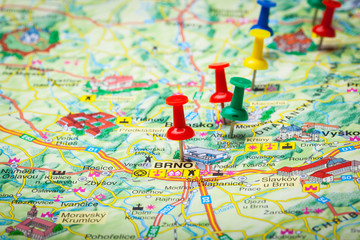 Travel destination points on a map indicated with colorful thumbtacks