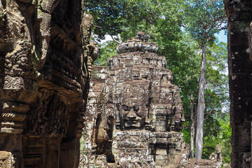 Gigantic Stone Face of Bayon in Angkor Thom, Cambodia