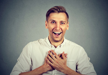 man looking shocked surprised laughing hands on chest
