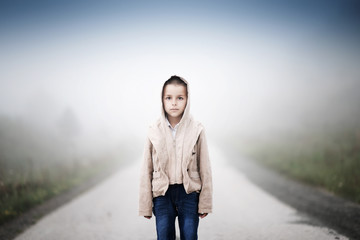 boy standing in the way shrouded morning fog