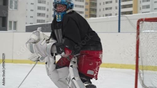 Slow Motion Of Ice Hockey Goaltender Protecting Teams Net Using
