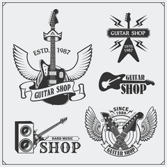 Set of guitar shop labels, emblems, badges and music icons.
