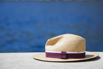Hat with sea landscape background. Concept of summer accessories