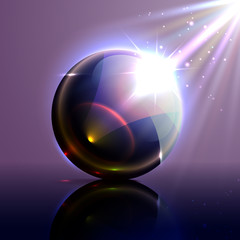 Vector glass ball with reflection and rays on a dark background