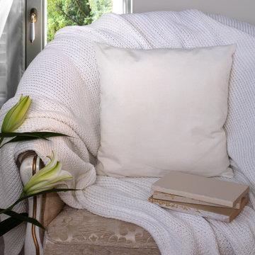 White pillow case Mockup. Pillow on chair in the room.