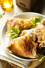 Fried chicken with spices and fresh parsley