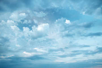 white clouds on the blue sky at evening