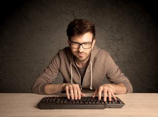 Computer geek typing on keyboard