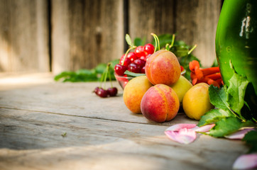 Still life of summer fruits. orange peaches, red cherries and gr
