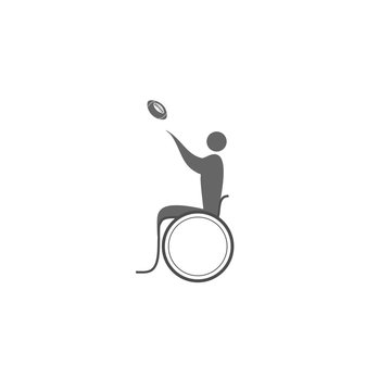 A disabled person in a wheelchair playing rugby.