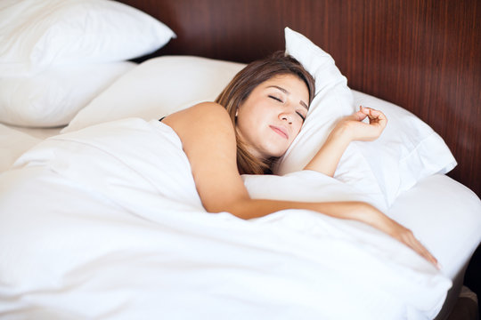 Cute woman sleeping on a bed
