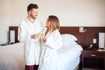 Couple making a toast with champagne