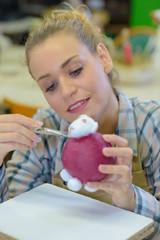 woman craftsman making animal crafts
