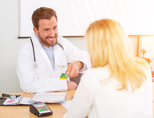 Young attractive doctor listening his patient