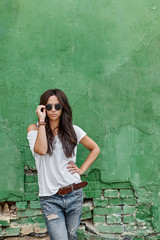 Beautiful young stylish woman in sunglasses