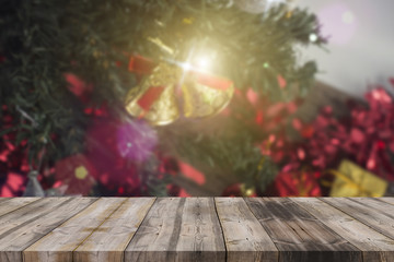 Christmas holiday background with empty wooden deck table over w