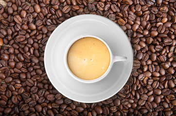 Cup of coffee on coffee beans background. 3d illustration