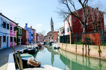 Brightly painted houses, tilted tower in Burano