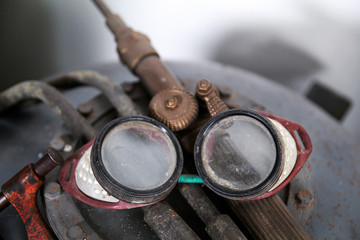 Old protective goggles for welding and grinding
