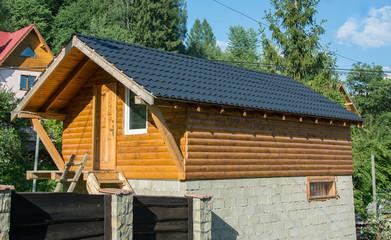 Wooden round timber garage extension