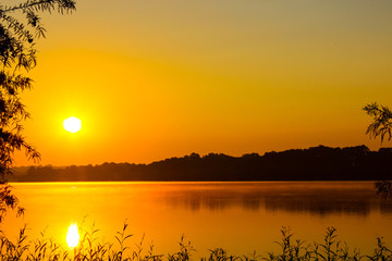 Sunrise on a fog covered lake