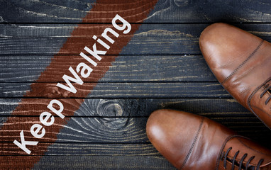 Keep Walking message and business shoes