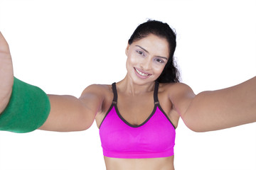 Indian woman with sportswear taking selfie