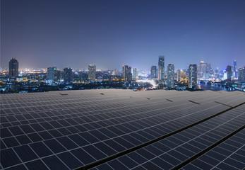 Solar panel,Solar farm with twilight cityscape