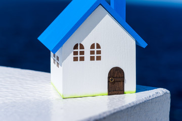 Home image, blue house toy under blue sky