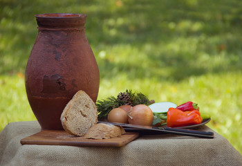 Traditional Food with Pottery and Bread,Vegetables with Grass Background